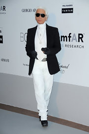 Karl paired his all white ensemble with a black blazer.