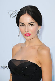 Camilla added a fierce pop of color to her classic look with fuchsia pink lips.
