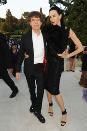 Mick Jagger looked dapper while posing for a picture at amfAR's Benefit Gala in his classic black suit.