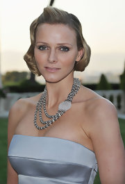 Charlene wore a glamorous wavy hairstyle with smokey eyeshadow to complement her evening gown.