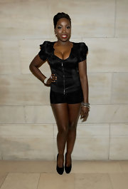 British singer Estelle showed off her short haircut at the amfAR Gala.