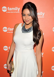 Shay Mitchell added glamour to her look with a gold clutch embellished with crystals.
