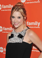 Ashley Benson highlighted her adorned neckline with a messy updo. Soft tendrils helped frame her face.