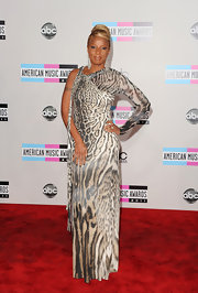 Mary J. Blige tapped into her animal instincts at the AMAs. Mary donned a fierce one-sleeved animal print gown. A sleek updo was the perfect accessory for this daring look.
