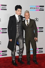 Sauli Koskinen looked trim and stylish in his dark gray suit.