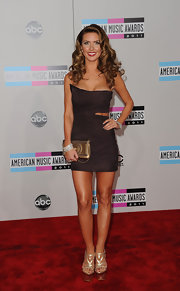 Audrina Patridge topped off her sexy red carpet frock with metallic platform sandals.