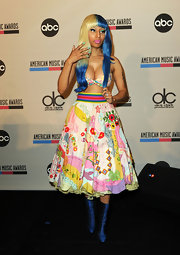 Nicki Minaj's wardrobe is always full of surprises. The pop artist donned a high-waisted quilted skirt for the AMA nominations conference.