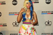 Recording artist Nicki Minaj poses onstage during the 2011 American Music Awards Nominees Press Conference at JW Marriott Los Angeles at L.A. LIVE on October 11, 2011 in Los Angeles, California.