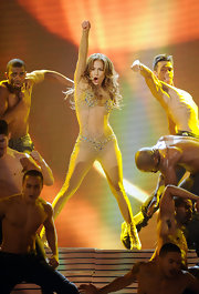 Jennifer Lopez channeled Britney Spears during her performance at the AMAs in a nude bodysuit covered with carefully placed rhinestones.