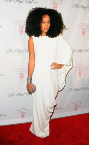 Solange Knowles complemented her white Grecian style gown with a shimmery gemstone-encrusted clutch.