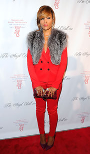 Eve was a vision in red at the 2011 Angel Ball teamed a crimson suit with a burgundy envelope clutch.
