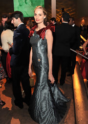 Lauren Santo Domingo looked exquisite at the Apollo Circle Benefit in a metallic gown with velvet bow adorned shoulders.