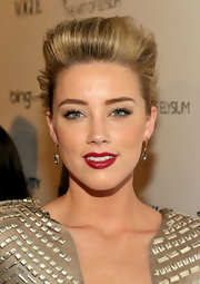 Actress Amber Heard added a sultry touch of color to her demure look with a crimson red pout. Sexy!