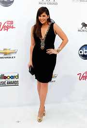 Hillary Scott matched the gold embellishment of her LBD with metallic peep-toe platforms.