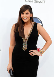 Hilary Scott paired her plunging gown with a stone encrusted gold cuff bracelet.
