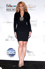 Here's a first! Beyonce opted for a low-key Lanvin LBD for the Billboard Music Awards. The long-sleeve number's focal piece was a sparkling design at the bust, matching her silver Louboutin heels and Lorraine Schwartz earrings. Perhaps Beyonce wanted to take things down a notch after her risque performance look!