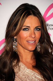 Actress Elizabeth Hurley attended the 2011 Breast Cancer Research Foundation's Hot Pink Party wearing Moonlight earrings in 18-karat yellow gold with assorted gemstones and diamonds.