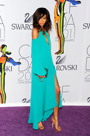 Chanel Iman paired her vibrant aqua gown with a turquoise clutch with a gold strap at the 2011 CFDA Awards.