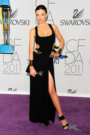 Miranda Kerr gave her sultry CFDA Awards look the perfect finish with a black python clutch.
