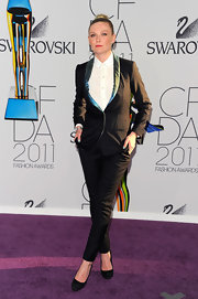 Kirsten Dunst paired her smart tuxedo with black satin pumps at the 2011 CFDA Awards.