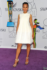Kerry Washington put her best foot forward at the CFDA Awards in stunning white strappy sandals with wood and lucite platforms.