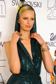 Karolina Kurkova  paired her sequin jumpsuit with cuff bracelet in gold.