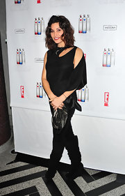 Gina Gershon added shimmer to her all black look with a soft metallic clutch.