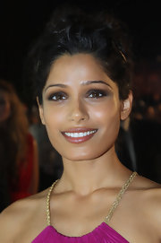 Frieda Pinto created a smoky-eyed look with shimmering neutral shades of shadow at the 2011 Doha Tribeca Film Festival.