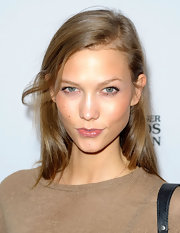 Karlie Kloss kept it simple with this loose side-parted 'do when she attended the 2011 Kids for Kids Family Carnival.