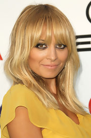 Nicole Richie's new cut has piece-y layers around her face and a few more throughout to give lots of texture and movement. To add even more texture and also some shine to a similar cut, try spritzing on a product like Charlotte Ronson A Perfect Mess Beach Hair on damp tresses before blow-drying.