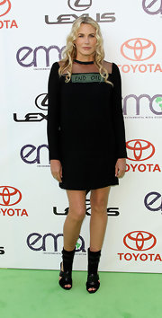 "Daryl Hannah made a statement with her dress at the Environmental Media Awards. Her black long-sleeve frock read ""End Oil."""