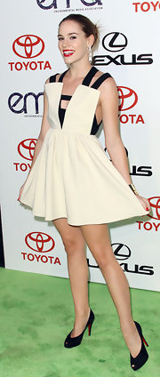 Christa B. Allen topped off her fun and flirty black and white dress with black platform pumps.