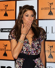 Eva Mendes paired her floral dress with assorted diamond bangle bracelets.