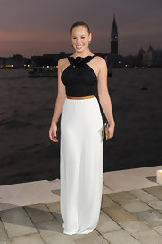 Abbie Cornish was stunning in a black and white matte satin gown with an embellished neckline and a cinched waist. She finished off the look with green earrings for a pop of color.