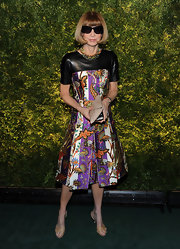 Anna Wintour kept all eyes on her Balenciaga dress with demure nude leather sandals.