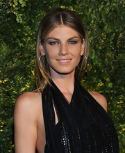 Angela Lindvall attended the 2011 Green Auction wearing gold hoop earrings with decorative gemstones.