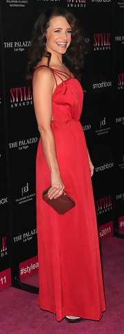 Kristin Davis accessorized her tomato red gown with a bronze frame clutch at the 2011 Hollywood Style Awards.