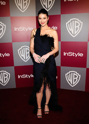 Mary wore a romantic navy gown with feather trim at the Golden Globes after party.