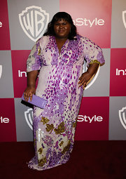 "Gabourey carried a lavender rectangular clutch at the 2011 ""InStyle"" Golden Globes party."