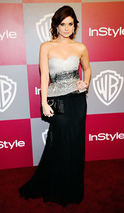 Joanna Garcia hit the 'InStyle'/Warner Brothers Golden Globes party carrying a ruched black satin clutch.