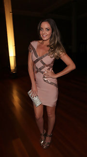 Amber Renee complemented the metallic beading of her dress with matching pewter platform sandals.
