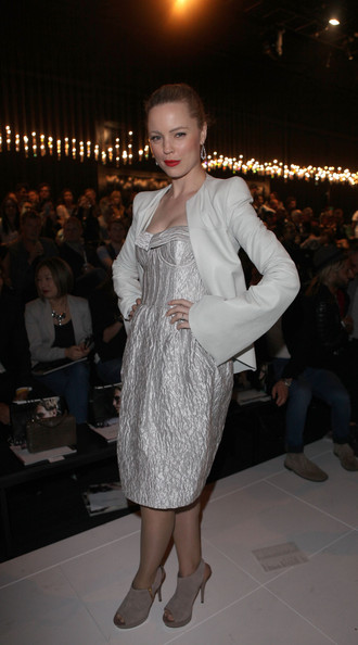 Melissa George teamed her metallic dress with taupe suede cutout booties.