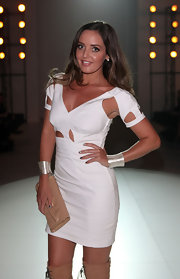 Amber Renee paired her cut out white dress with a chunky silver cuff bracelet.