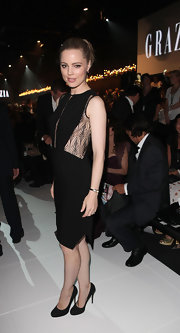 Melissa George balanced her lacy black dress with matching pumps.