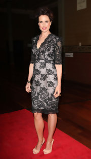 Andy wears a black lacy cocktail dress for the Melbourne Fashion Festival.
