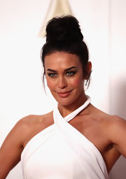 Megan Gale wore her hair piled high in a top knot when she attended the 2011 Logie Awards.