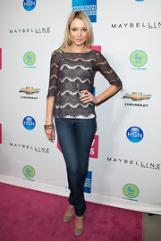 Katrine Bowden kept her casual red carpet look feminine in a gray scalloped lace top layered over a white tank.