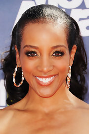 Shaun Robinson added shine to her look with twisted gold and diamond hoops.