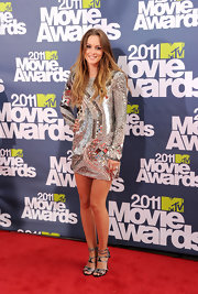 Leighton Meester added glitz to her metallic sequined frock at the MTV Movie Awards with strappy buckled black rhinestone-adorned sandals.