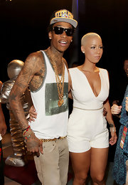 Wiz Khalifa has a star tattoo on his elbow that blends into his artistic shoulder design.